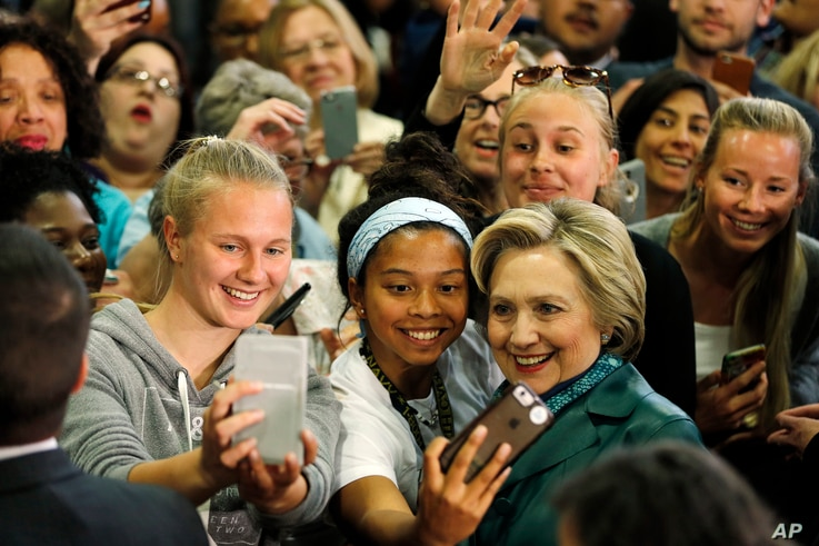 Democratic presidential candidate Hillary Clinton meets with attendees during a campaign stop, April 24, 2016, at the University of Bridgeport in Bridgeport, Conn.
