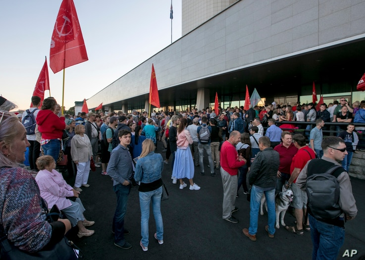FILE - People gather for a rally at the Primorsky Krai regional administration's building following gubernatorial elections in the region in Russia's Far East, Sept. 17, 2018.