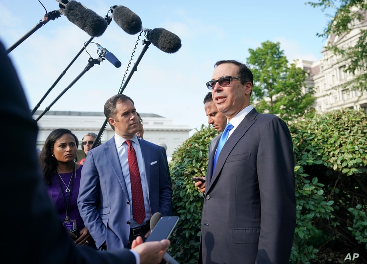 Treasury Secretary Steven Mnuchin speaks to members of the media at the White House in Washington, July 26, 2018.