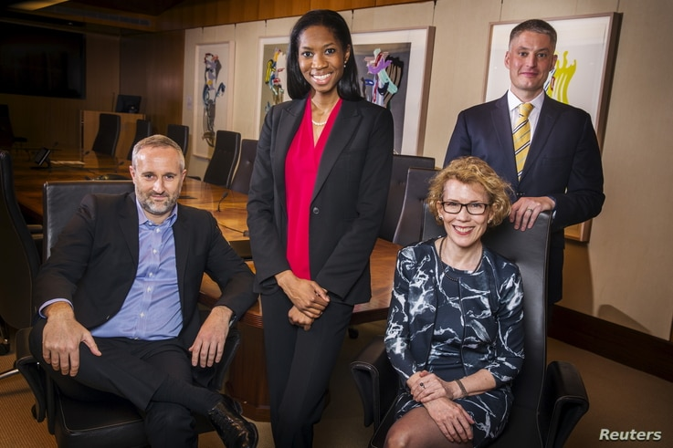 FILE - From left, LGBT activists Daniel Maury, Lanaya Irvin, Jennifer MacDonald and Matt Koehler, photographed in New York, April 13, 2015, were among such activists in finance who helped persuade several Wall Street firms to sign a brief on behalf o...