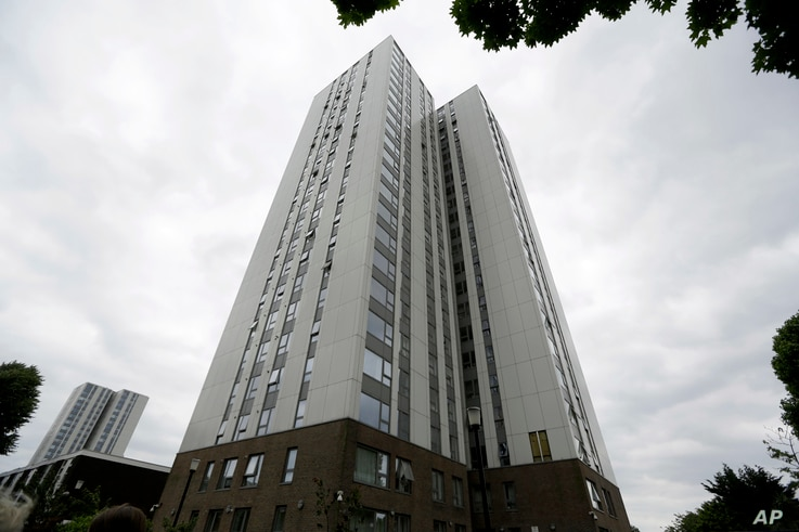 A view of Burnham residential tower on the Chalcots Estate showing the bottom section of the building after cladding  was removed, in the borough of Camden, north London, June 22, 2017. The cladding was deemed to be a safety concern in the aftermath ...