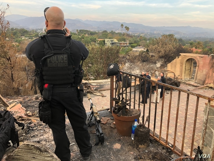 While a Secret Service member stands watch, President Donald Trump, along with California officials including, Gov. Jerry Brown and Gov.-elect Gavin Newsom, survey the damage done by the Woolsey Fire in Malibu, Calif., Nov. 17, 2018.