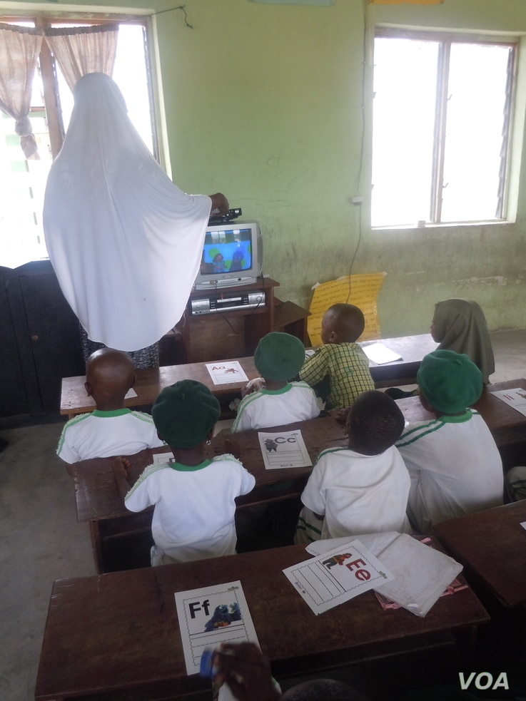 "Students watch ""Sesame Square"" with their teacher in a school in Ijebu-Lekki, Nigeria, February 2012. Naomi Moland, a lecturer at American University in Washington who studies the Nigerian version of ""Sesame Street,"" said the program producers trie..."
