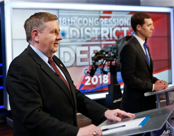 Republican Rick Saccone, left, and Democrat Connor Lamb before the taping of their first debate in the special election in the Pa., 18th Congressional District at the KDKA TV studios, Feb. 19, 2018, in Pittsburgh.