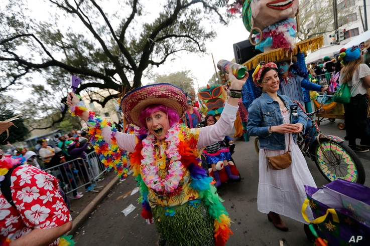 A member of the walking club Mondo Kayo revels as they march and dance down the route of the Krewe of Zulu parade on Mardi Gras day in New Orleans, Tuesday, Feb. 13, 2018.