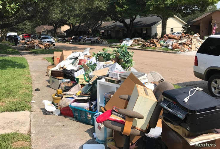 Damaged furniture, carpets and flooring are piled at the curbside by residents as many began repairs in the aftermath of Hurricane Harvey, in Houston, Texas, Sept. 2, 2017.