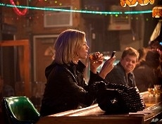 Left to right: Charlize Theron plays Mavis Gary and Patton Oswalt plays Matt Freehauf in YOUNG ADULT, from Paramount Pictures and Mandate Pictures.