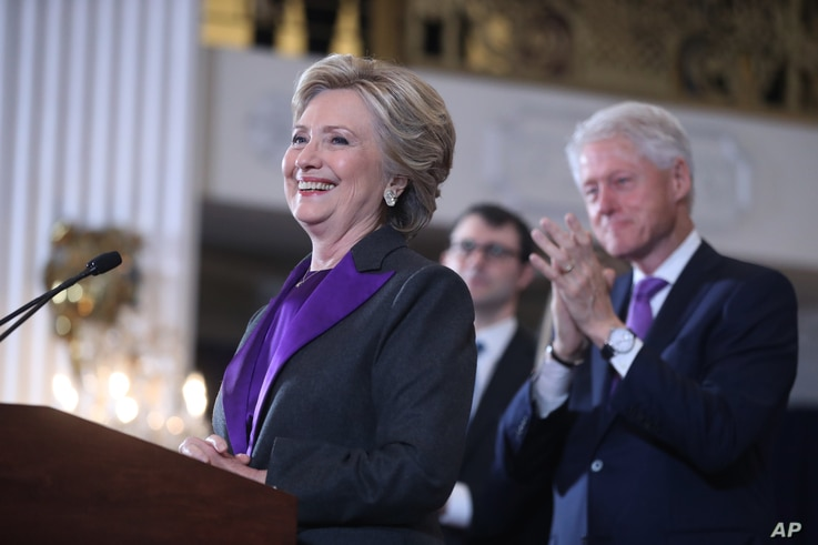 Former President Bill Clinton applauds as his wife, Democratic presidential candidate Hillary Clinton speaks in New York, Nov. 9, 2016.