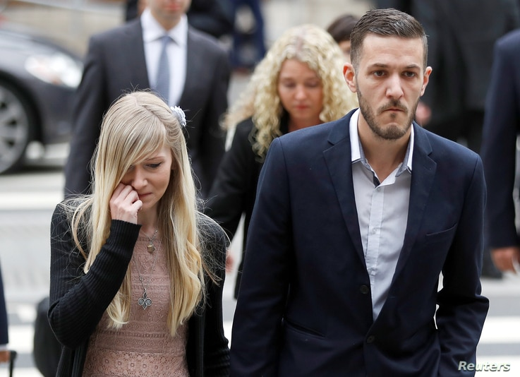 FILE - Charlie Gard's parents Coonie Yates and Chris Gard arrive at the High Court ahead of a hearing on their baby's future, in London, Britain July 24, 2017.
