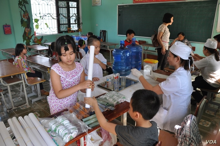 US AID deworming clinic in Vietnam's Bac Giang Province. Vietnam is another country where people have a high risk of contracting roundworm.