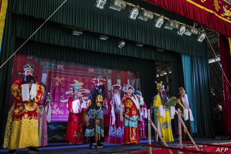 Chiu Chow Opera performers sing on stage as part of the Hungry Ghost Festival in Hong Kong
