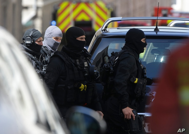 Elite police officers arrive during searches in Marseille, southern France, April 18, 2017.