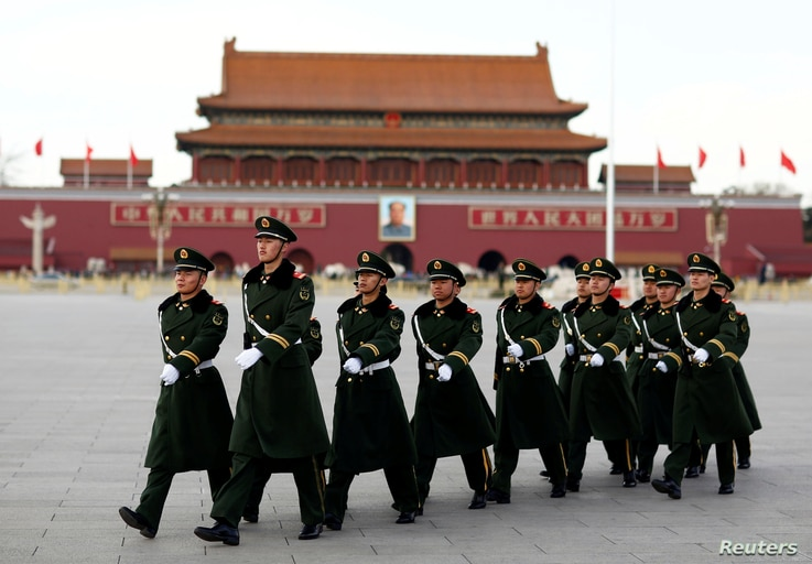 Paramilitary police walk in formation accross Tiananmen Square as the sessions of the National People's Congress are taking place in the nearby Great Hall of the People in Beijing, China, March 6, 2017.