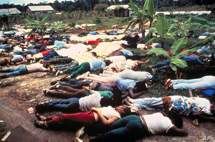 FILE - This Nov. 1978 file photo shows the bodies of Peoples Temple mass suicide victims led by Jim Jones in Jonestown, Guyana.