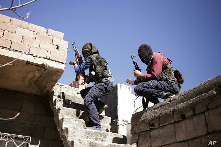 Militants from the Kurdistan Workers' Party, or PKK, run as they attack Turkish security forces in Nusaydin, Turkey, March 1, 2016.