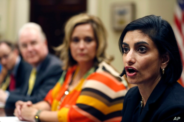 FILE - Dr. Douglas Lake, from Iowa, left, Health and Human Services Secretary Tom Price, Candace Fowler, from Missouri, listen as Seema Verma, Administrator of the Centers for Medicare and Medicaid Services, speaks during a listening session in the R...
