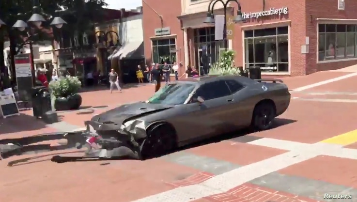 A vehicle is seen reversing after plowing into the crowd gathered on a street in Charlottesville, Virginia, U.S., after police broke up a clash between white nationalists and counter-protesters, Aug. 12, 2017, in this still image from a video obtaine...