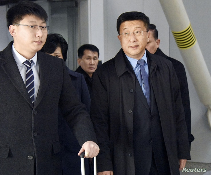 Kim Hyok Chol, right, North Korea's interlocutor leading negotiations with the United States, arrives at Beijing's international airport on his way to the Vietnamese capital Hanoi, Feb. 19, 2019.