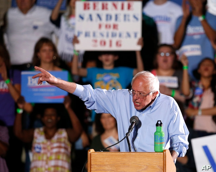Democratic presidential candidate Sen. Bernie Sanders, of Vermont, gestures during a campaign event in Tucson, Ariz., Oct. 9, 2015.