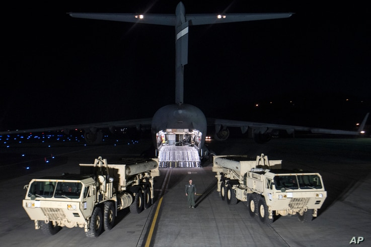 In this photo provided by U.S. Forces Korea, trucks carrying parts of U.S. missile launchers and other equipment needed to set up A Terminal High Altitude Area Defense (THAAD) system arrive at Osan air base in Pyeongtaek, South Korea, March 6, 2017.