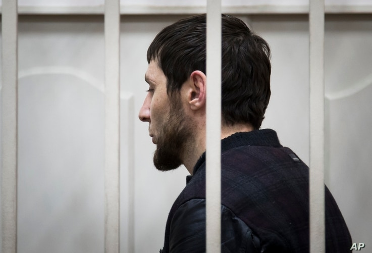 Zaur Dadayev, one of five suspects in the killing of Boris Nemtsov stands in a courtroom in Moscow, Russia, Sunday, March 8, 2015.