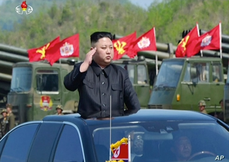 "This image, from a news bulletin by North Korea's KRT, April 26, 2017, shows leader Kim Jong Un at a ""Combined Fire Demonstration"" held to celebrate the 85th anniversary of the North Korean army, in Wonsan, North Korea."