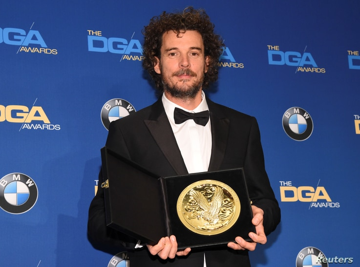 """Garth Davis, winner of the First-Time Feature Film award  for his work on """"Lion,"""" poses for photographers at the 69th annual DGA Awards in Beverly Hills, California, Feb. 4, 2017."""