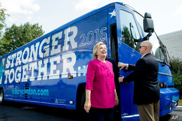 Democratic presidential candidate Hillary Clinton gets off her campaign bus as she arrives for a rally at K'NEX, a toy company in Hatfield, Pa., July 29, 2016.