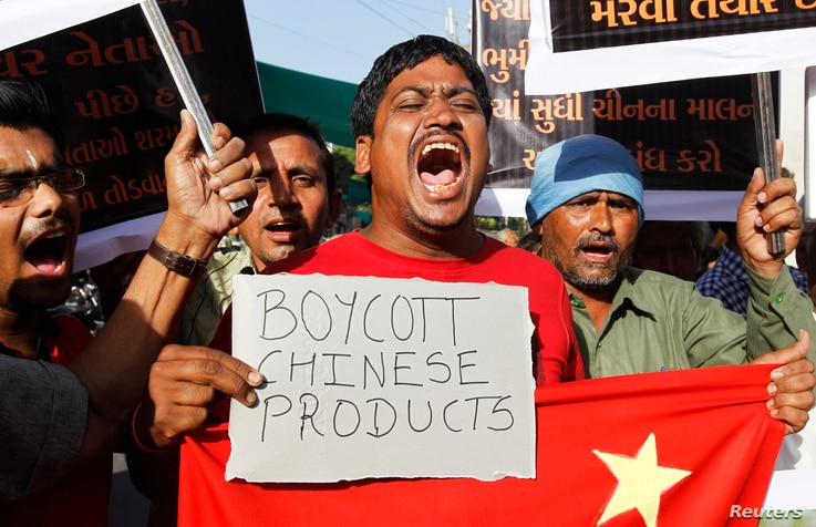 Traders shout slogans during a protest against China in the western Indian city of Ahmedabad May 3, 2013. They were demanding the withdrawal of Chinese soldiers after they set up a camp in a remote part of Ladakh, territory claimed by India in the Hi...
