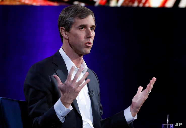 """FILE - Former Democratic Texas congressman Beto O'Rourke during an interview with Oprah Winfrey live on a Times Square stage at """"SuperSoul Conversations,"""" Feb. 5, 2019, in New York."""
