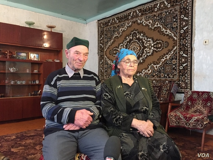 Azime Umerova (L) and Rustem Umerov were children when Stalin's security forces deported them from Crimea in 1944.  To them, Mocow's annexation of the peninsula has been another chapter in a long history of Russian persecution of the Tatar people. (L...