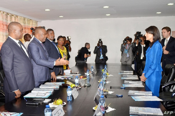 U.S. Ambassador to the United Nations Nikki Haley (R), meets Democratic Republic Congo's national independent electoral commission's president, Corneille Nangaa Yobeluo, at the commission's headquarters in Kinshasa, DRC, Oct. 27, 2017.
