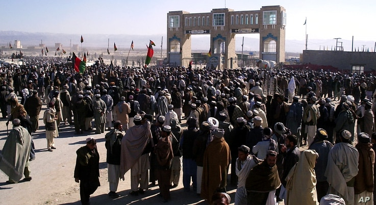 FILE - Pashtun tribesmen gather at Pakistan-Afghanistan border post at Chaman to protest against stricter border controls introduced by Pakistan, Thursday, Jan. 11, 2007 in Waish, Afghanistan.