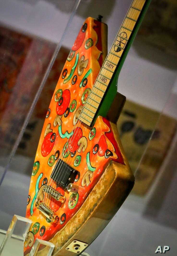 """The """"Pizza Guitar,"""" from musician Andrew W.K., is part of a group art exhibition celebrating pizza at The Museum of Pizza in New York, Nov. 2, 2018."""