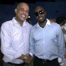 Haitian President-elect Michel Martelly (l) with singer Wyclef Jean after announcement of preliminary election results in Haiti, April 4, 2011