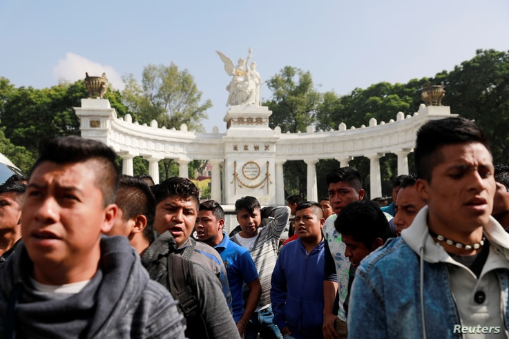 Students of Ayotzinapa College Raul Isidro Burgos demonstrate outside the Museum of Memory and Tolerance before a meeting between the parents of 43 missing students who disappeared on Sept. 26, 2014 and President-elect Andres Manuel Lopez Obrador in ...