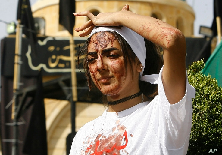 A Lebanese Shi'ite woman bleeds from self-inflicted head wounds to show her grief during Ashura rituals in Nabatieh, Oct. 12, 2016.