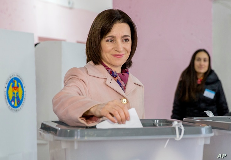FILE - Leader of the Action and Solidarity Party, Maia Sandu, casts her vote during the presidential elections in Chisinau Moldova, Oct. 30, 2016. Sandu and Igor Dodon, a Socialist former trade minister, will face off in a November 13 run-off.