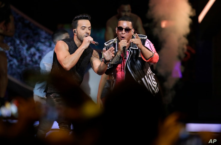 Singers Luis Fonsi, left and Daddy Yankee perform during the Latin Billboard Awards,  April 27, 2017 in Coral Gables, Fla.