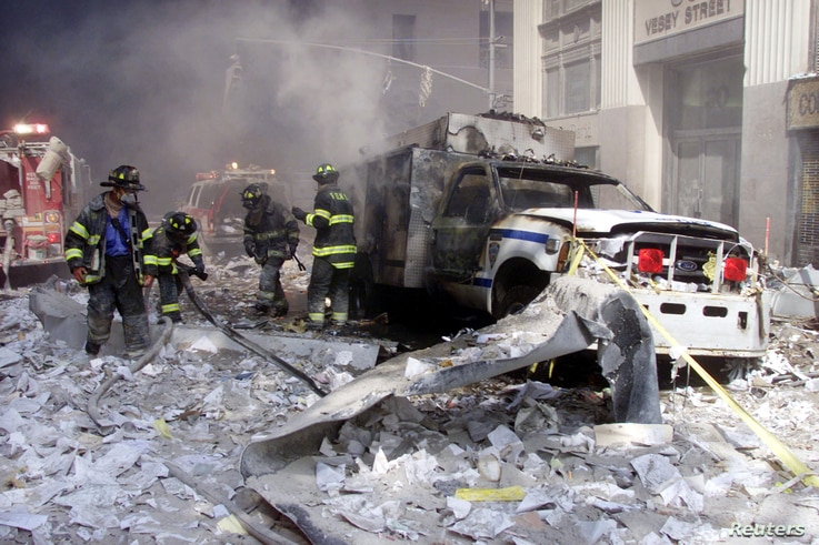 A police car sits amid rubble near the base of the destroyed World Trade Center towers in New York on September 11, 2001. Exposure to toxic dust led to a host of respiratory diseases and cancer in first responders.