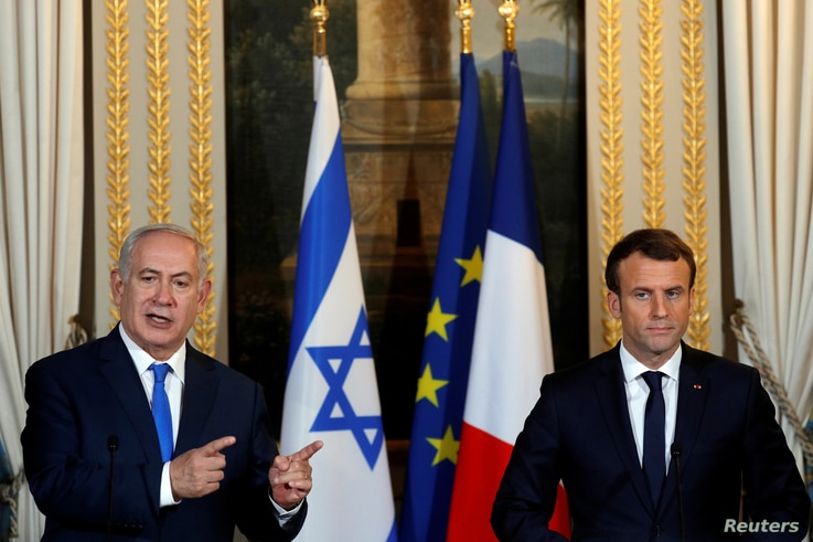 French President Emmanuel Macron and Israeli Prime Minister Benjamin Netanyahu attend a joint news conference at the Elysee Palace in Paris, Dec.  10, 2017.