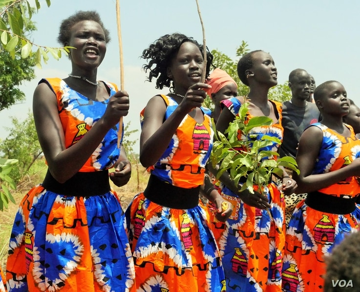 South Sudanese women at Pagirinya Refugee Settlement wore bright costumes, welcoming the UN High Commissioner with song and dance.