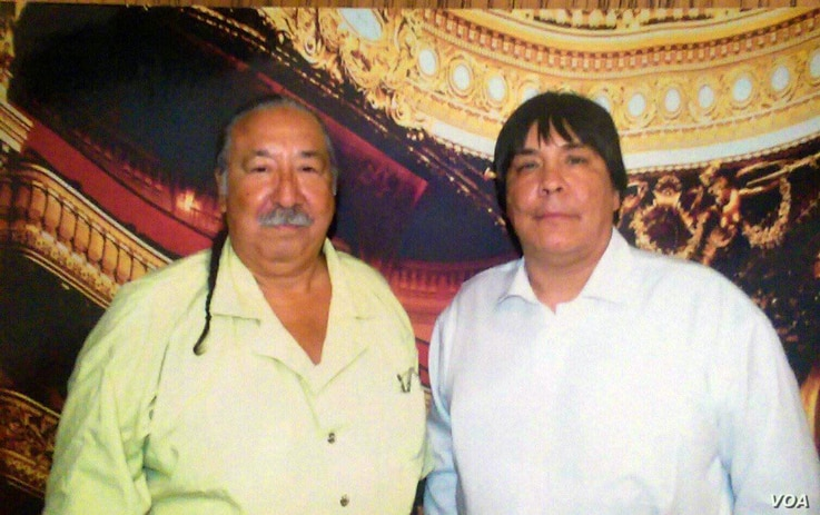 Photo shows Chauncey Peltier (R) and father Leonard Peltier (L) during a rare visit to the US Penitentiary Coleman, Florida, May 17, 2015.  Courtesy Chancey Peltier
