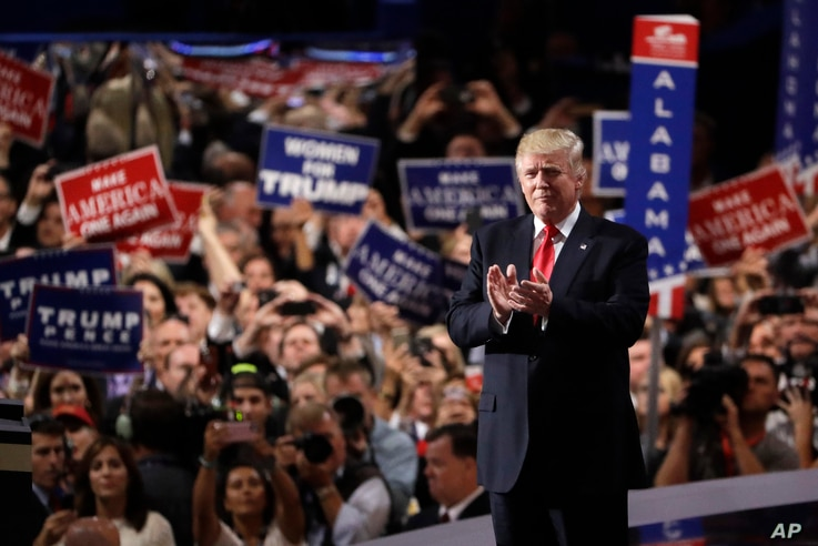 Republican presidential candidate Donald Trump takes the stage during the final day of the Republican National Convention in Cleveland, July 21, 2016.
