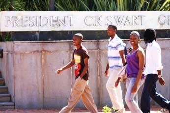 Black students walk past a university building named after President C.R. Swart, one of apartheid South Africa's leaders