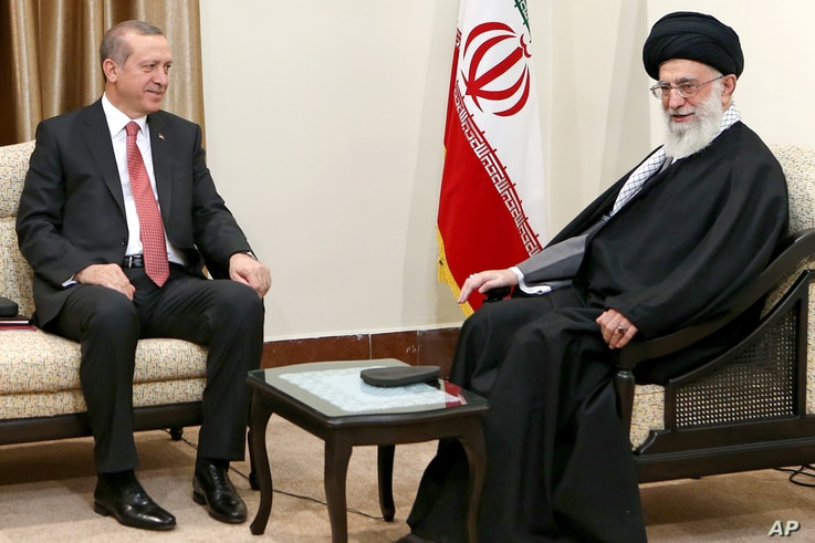 FILE - In this photo released by an official website of the Iranian Supreme Leader office, Supreme Leader Ayatollah Ali Khamenei, right, talks with Turkish President Recep Tayyip Erdogan during their meeting in Tehran, Iran, April 7, 2015.