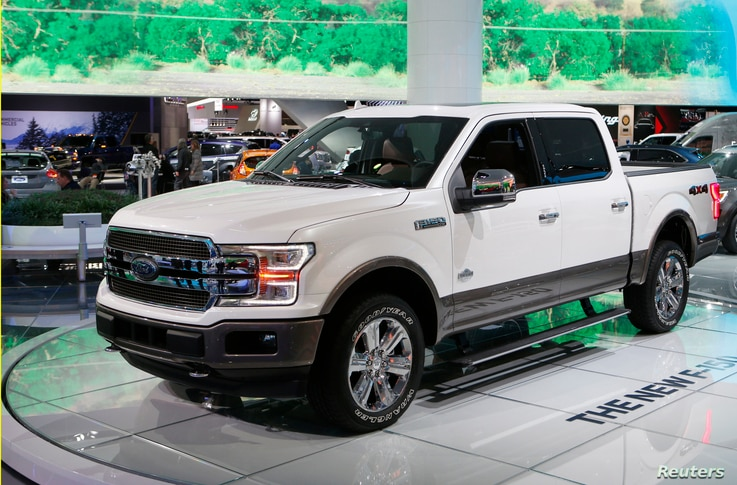 """A 2018 Ford F-150 """"King Ranch"""" pickup truck is displayed during the North American International Auto Show in Detroit, Mich.,  Jan. 10, 2017. The F-150 is one of several 2018 Ford models on which automatic braking will be offered."""