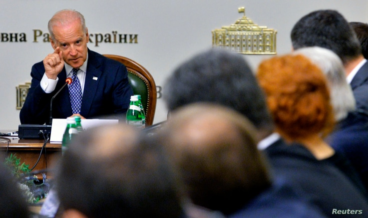 US Vice President Joe Biden addresses to members of the Ukrainian parliament during a meeting in Kiev, April 22, 2014. Biden told Ukrainian members of parliament in Kiev, including presidential candidates, that the United States was ready to help Ukr...
