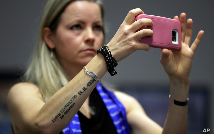 Erin Miller, with a tattoo honoring the Women Airforce Service Pilots, attends a hearing as the Texas school board prepared to vote on history curriculum, Nov. 13, 2018, in Austin, Texas. Miller spoke in defense of keeping the Women Airforce Service ...