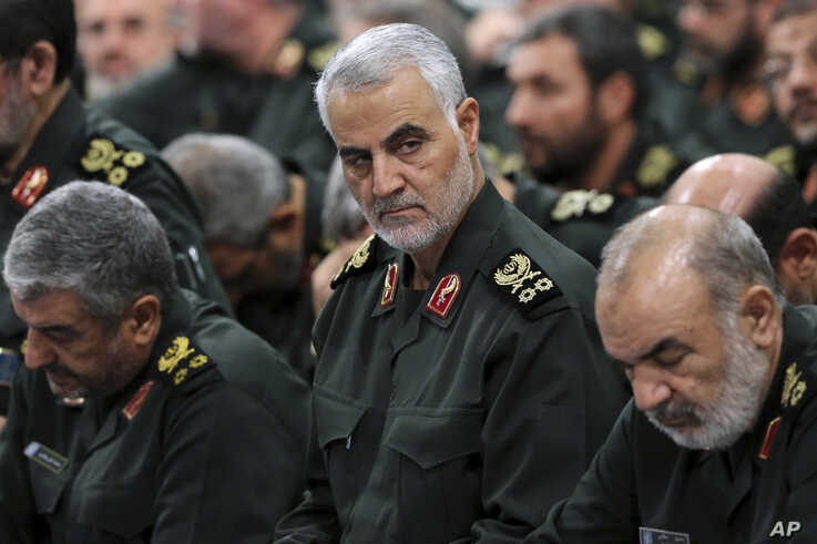 FILE- A photo released by an official website of the office of the Iranian supreme leader, shows Revolutionary Guard Gen. Qassem Soleimani (C) attending a meeting with Supreme Leader Ayatollah Ali Khamenei and Revolutionary Guard commanders in Tehran...